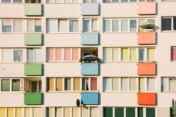 Full frame of building with colorful balconies