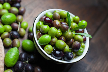 High Angle View Of Green Olives On Table