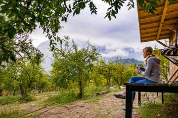 A Woman Enjoying A Morning Cup Of Coffee In Geyikbayiri, Turkey