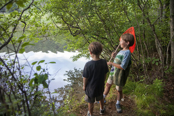 Nine-year-old and six-year-old brothers look for salamanders