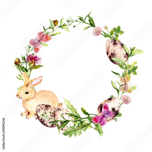 Easter Wreath With Easter Bunny Colored Eggs In Grass Flowers