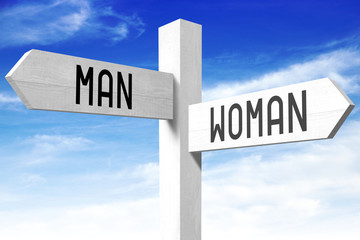 Man, woman - wooden signpost