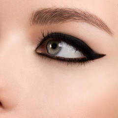 Beauty makeup for blue eyes. Part of beautiful face closeup. Perfect skin, long eyelashes. Make up concept.