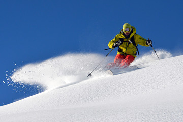 Man skiing on snowy mountain landscape Wall mural