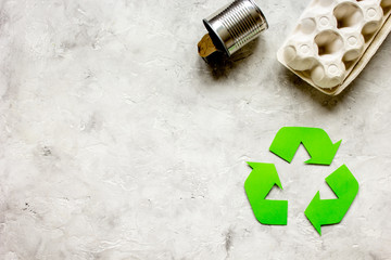 recycling symbol with waste on gray background top view mock up