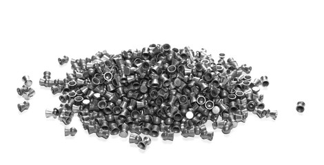 Pile lead pellets for air rifle isolated on white