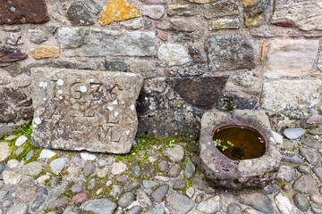An ancient stone engraving at Castle Campbell near Dollar, Scotland.