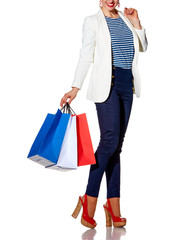 Smiling young woman with French flag colours shopping bags