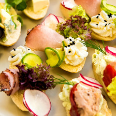 Catering service buffet plate with canapes and sandwiches on a plate