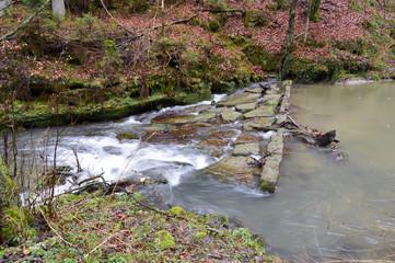 Small waterfall on a stone dam