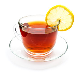 Isolated transparent cup of tea with lemon slice