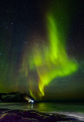 Aurora borealis (Polar lights) over the mountains in the North of Europe - Steinfjord, Lofoten islands, Norway