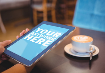 User with a Tablet in a Coffee Shop Mockup 3