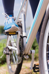 Foot on bicycle pedal