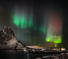 Aurora borealis (Polar lights) over the mountains in the North Europe - Reine, Lofoten Islands, Norway