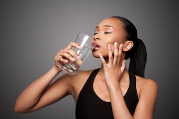 Happy healthy black asian woman enjoying water