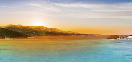 Panoramic Sunrise over the sea and famous Greek island Corfu, aerial shot