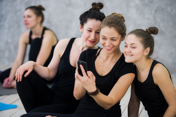 Yoga class of cheerful millennial friends people takes a selfie