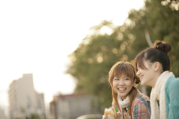 Smiling young women outside