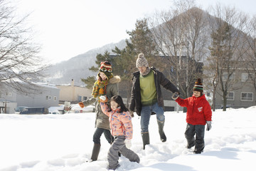 Family walking in the snowfield