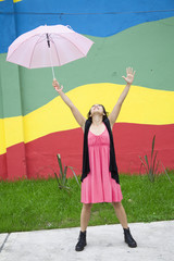 Young woman with an open umbrella