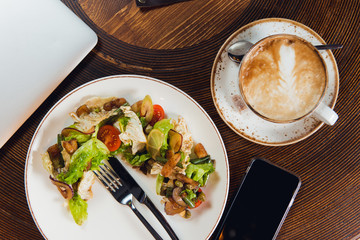 Restaurant meal and coffee with smartphone. Relaxation recreation concept