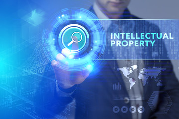 Business, Technology, Internet and network concept. Business man working on the tablet of the future, select on the virtual display: Intellectual property