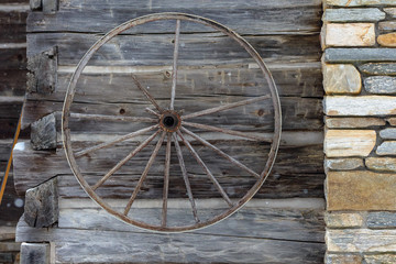 Old Wagon Wheel on Log Cabin