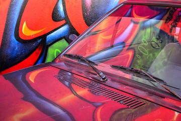 graffiti reflection on the car