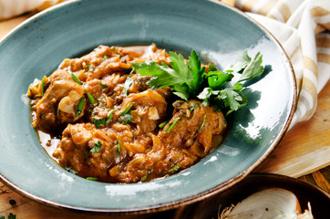Chakhokhbili. Stewed poultry meat in tomato sauce with spices and garlic