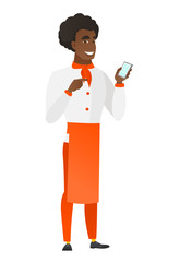 African-american chef cook holding a mobile phone.