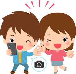 スマートフォンで自撮りする若い男女