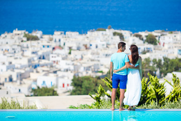Beautiful young couple at Mykonos island. Tourists enjoy their greek vacation background famous Mykonos village