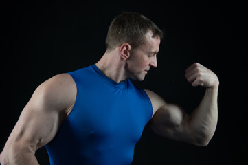 handsome bodybuilder man with muscular body training in gym
