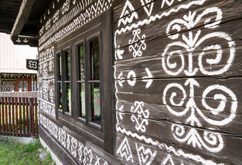 Closed windows on wooden rural ornamental house in Cicmany, Slovakia