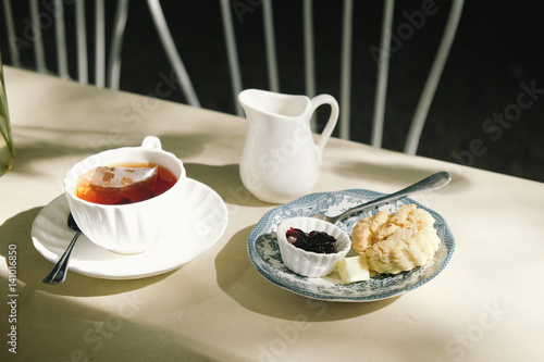 british afternoon tea break scones with blue berry fruit jam and clotted cream close up on the. Black Bedroom Furniture Sets. Home Design Ideas