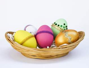 Easter egg collection in bamboo basket, colorful egg in basket on blue background