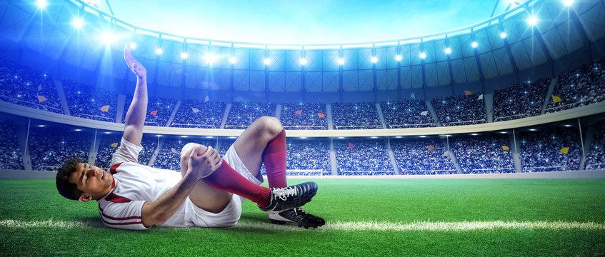 Injured football player on stadium field