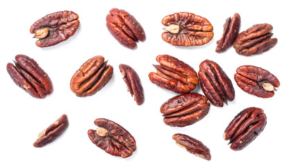 roasted pecan fruits on white, overhead view