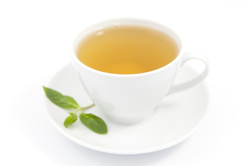 green tea in white cup on top of a white background.