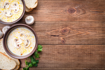 Mushroom  soup  on a  rustic wooden background .