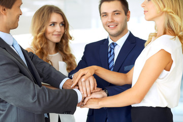 Happy smiling businessman and his colleagues pointing by finger into the camera. Concept of employer and success team.