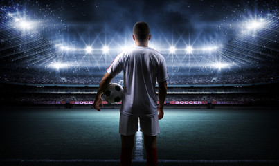 Fototapete - Football player with ball on field of stadium