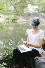 Young Beautiful Woman Using a Laptop in Central Park , Manhattan, New York City US