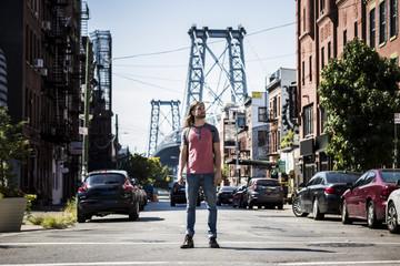 Solitary man in Williamsburg, Brooklyn, NYC // Williamsburg Bridge as background