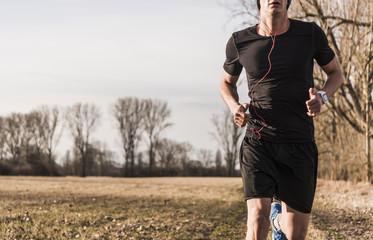 Man running in rural landscape