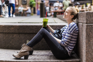 Female tourist walking in downtown Manhattan