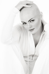 Black and white photo of young beautifil skinhead woman