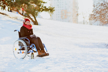 happy woman on wheelchair in the snow
