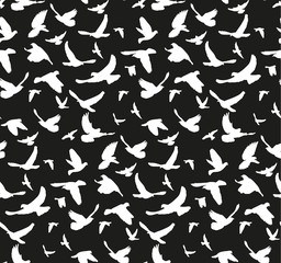 seamless pattern, silhouette of flying birds On a black background